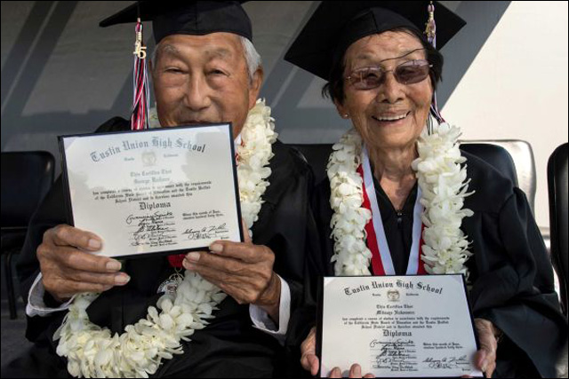 George and Miko Kaihara in their cap and gown with their diplomas